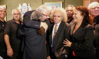 Kevin Rudd hugs members of the stolen generations during a breakfast in Sydney to mark the anniversary of the national apology.