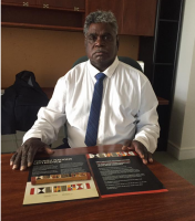 Yingiya Mark Guluya MLA, Member for Nhulunbuy presenting the Yolngu Nations letterstick about teaty and sovereignty to parliament on 18 October.